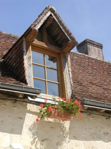 Example of a gabled dormer window on a French country house